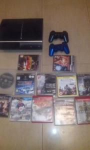 Playstation 3 with 2 controllers and 11 video games
