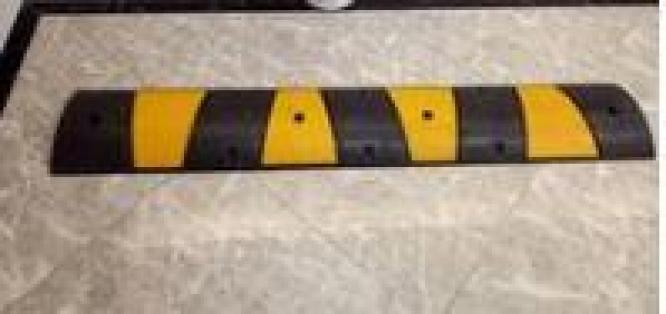 Rubber Speed Bump With 4 Lag Bolts By HIPHEN SOLUTIONS SERVICES LTD.